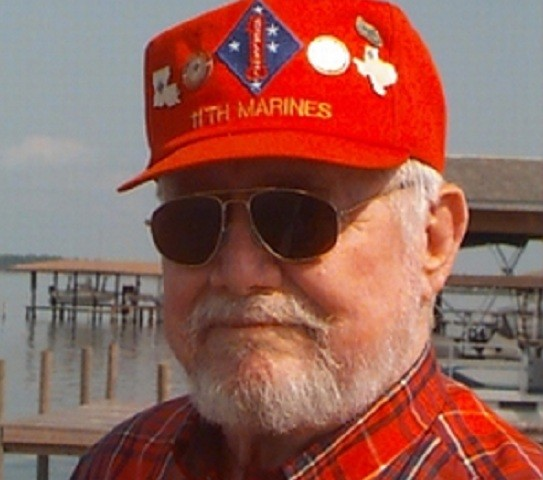 Man in an uncool baseball cap