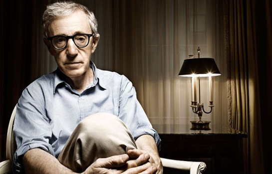 Woody Allen in a room with low light