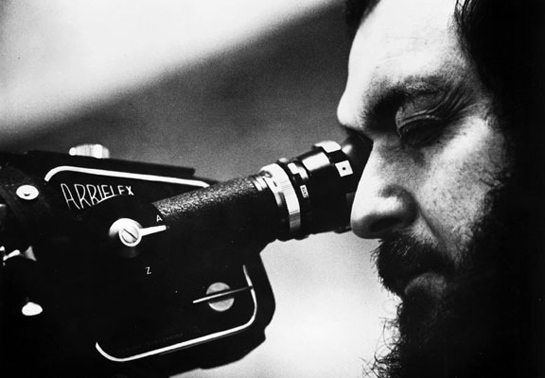 Stanley Kubrick looks into a video camera