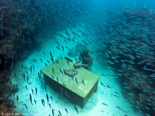Jason deCaires Taylor's underwater art in Mexico featuring a desk adorned with fish