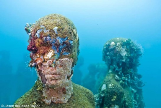 Jason deCaires Taylor's underwater art in Mexico featuring figures of people with moss