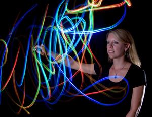 Natasha Bacca creating multicolored art on a screen