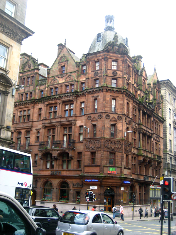 an old red building on the streets of Glasgow Scotland