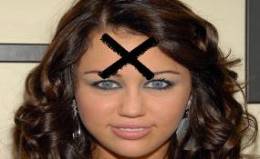 Hannah Montana/Myley Cyrus with an X on forehead - stupid