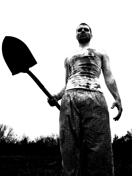 scary looking dude holding a shovel from a film called burning inside