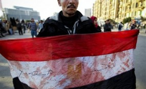 Egyptian man with bloody flag