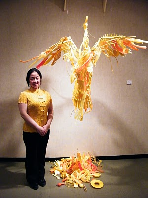 Sayaka Ganz standing beside her art installation