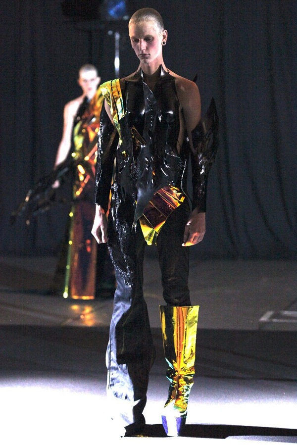 Runway photograph of a Yuima Nakazato's Fashion Show featuring a blonde model in wild outfit