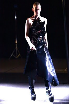 Runway photograph of a Yuima Nakazato's Fashion Show featuring a model in giant boots