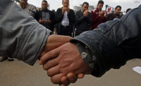 Egyptian protesters holding hands