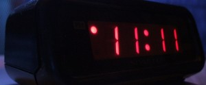 picture of bedside alarm clock reading 11:11