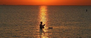 Picture of man fishing in river at sunset in Texas
