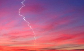 Photo of crooked smoke trail in sky at dawn