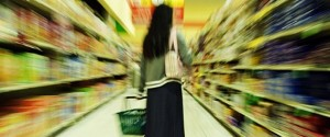 artsy picture of woman overwhelmed in supermarket aisle