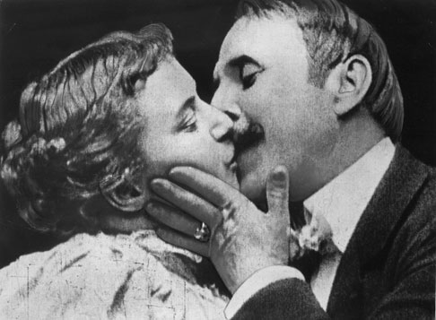 A still frame from the 1896 film The Kiss