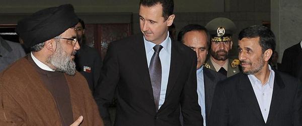 Lebanon's Hezbollah chief Hassan Nasrallah, Syrian President Bashar al-Assad and Iranian President Mahmou