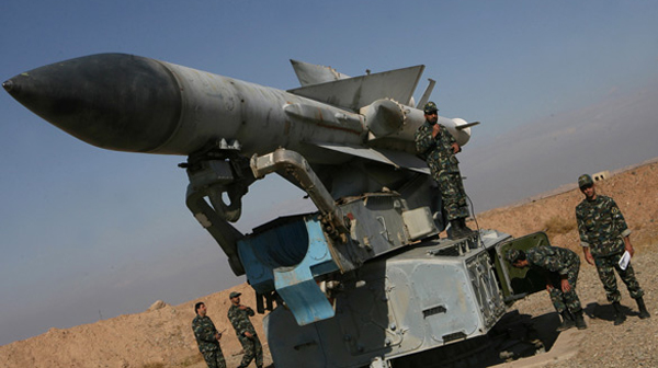 Iranian soldiers stand near a S-200 surface-to-air missile during military manoeuvres in Iran. (Ali Shayegan/AFP/Getty Images)